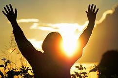 christian-woman-worships-praises-god-hoping-answered-prayer-silhouette-portrait-set-against-beautiful-setting-sun-50789281